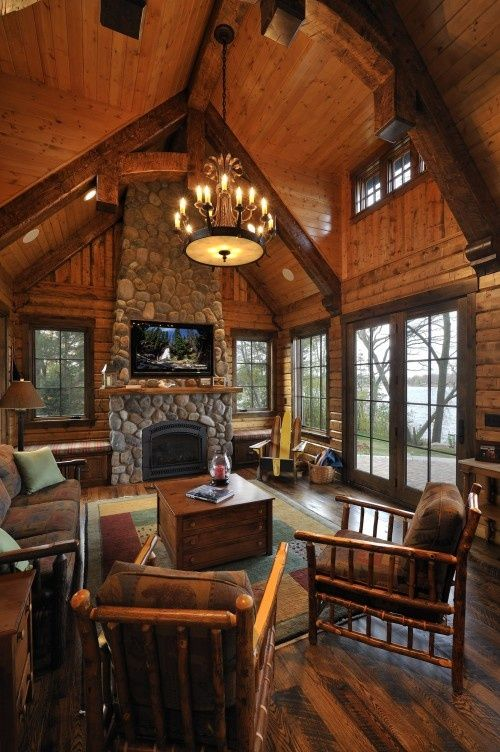 Rich wood floors, cathedral ceiling, large picture windows, stone fireplace w/built-in TV– love it!  If it were mine, I'd go with leather furniture.