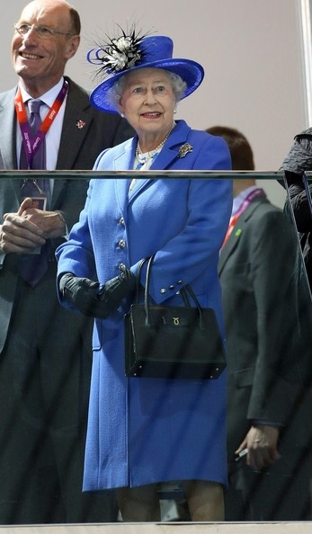 Queen Elizabeth II and Sebastian Coe visit the Aquatics Centre for the Swimming competitions during the London Olympic Games held at the Olympic Park in London
