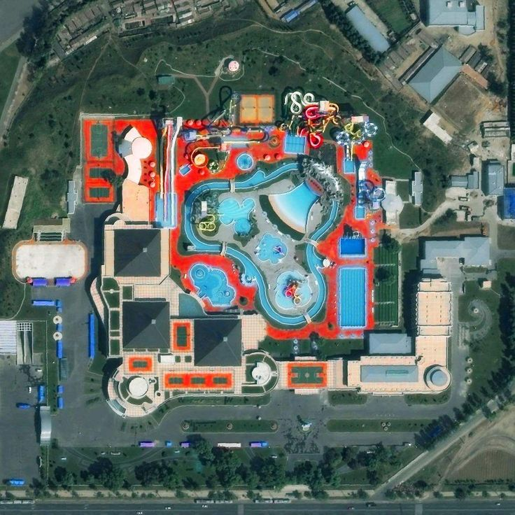 Munsu Water Park is located in Pyongyang, North Korea. The facility is open year-round with water slides, indoor and outdoor swimming pools, various sport courts, and a rock climbing wall.  Instagram: http://bit.ly/2uNJkPE  39.039177°, 125.780009°  Source imagery: DigitalGlobe
