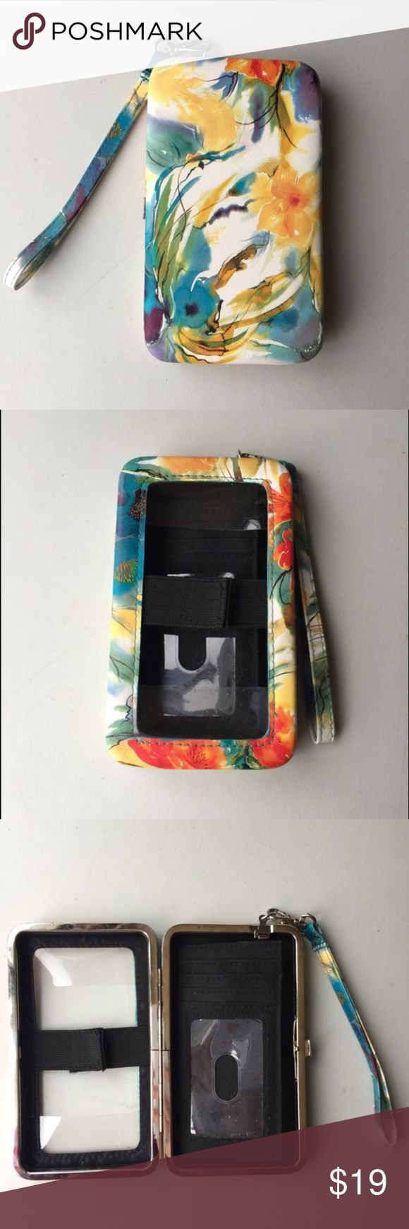 Beautiful colorful tech wristlet This wristlet has a gorgeous watercolor pattern with floral detail. Blue, green, white, yellow, orange, purple, and red. Fits many types of phones with access to the smartphone screen when it is closed. Seems to be shaped for an iPhone, but similar sized phones would work also because it's not precise sizing. Room for cards, ID, and cash as well. Detachable strap. Very pretty case wallet for everyday use! Tags: colored, button, cell phone, flower, gorgeous…