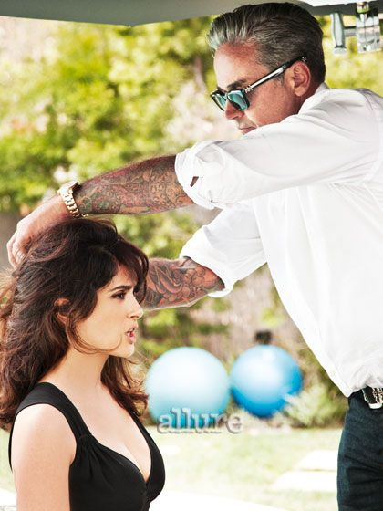 """For her September cover, Testino photographed Hayek at a beachfront house in Malibu, California. Hairstylist Oribe, shown here, wanted to give her a wavy Brigitte Bardot style for the shoot. He gave her hair """"a few turns"""" with a curling iron, removing the iron quickly to keep the curl loose. For added (but not exaggerated) height at the crown, he used Oribe Dry Texturizing Spray at the roots."""