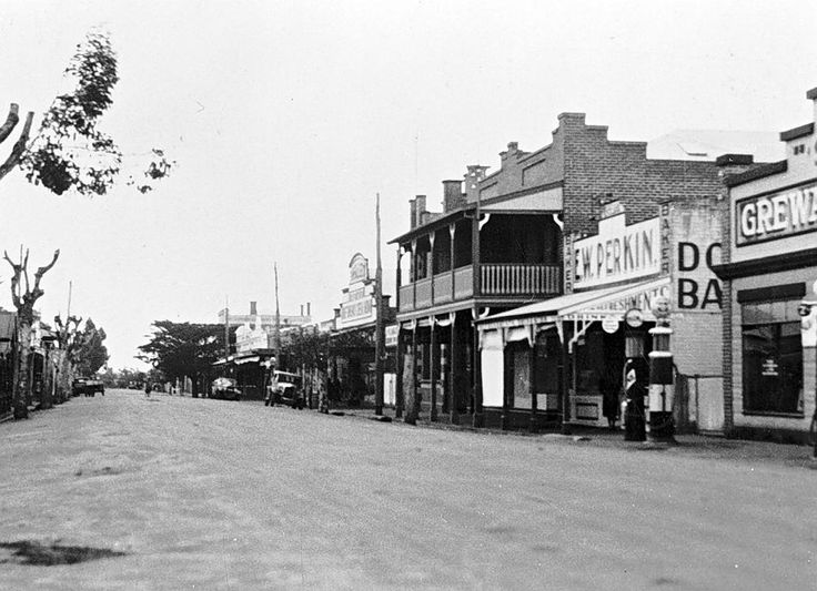 Main street in Donald. On the right, a hotel, E. W. Perkin, baker, and a garage, c1935.