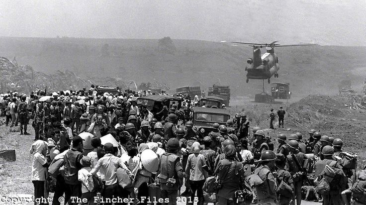 South Vietnamese refugees clamour to get a ride on a helicopter for the evacuation of the besieged town of Xuan Loc as the North Vietnamese Army advance. Photographed by Terry fincher. April 1975.