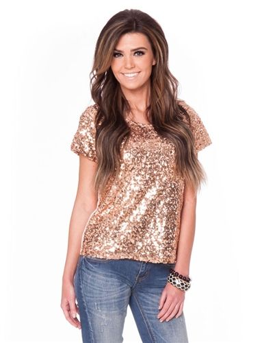 One word to describe this top? Gorgeous! This top is covered in rose gold sequins and is fully lined with cap sleeves and round neckline.