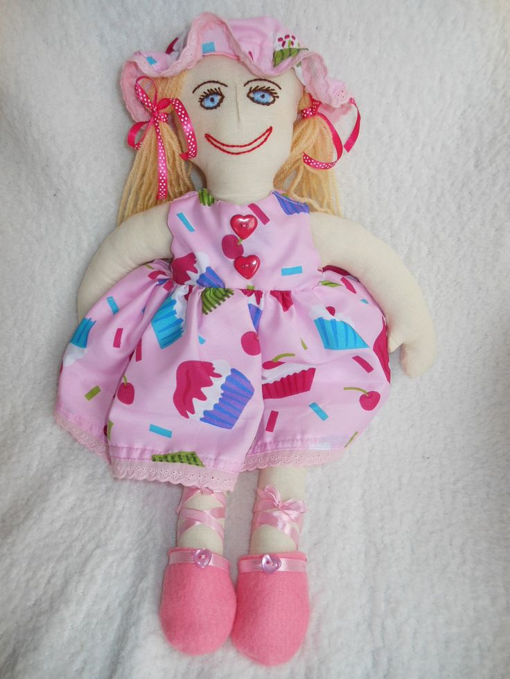 Jessie June our cute mop hat rag doll.  Her cupcake motif dress, hat and panties can be removed allowing the child playing with her to develop their fine motor skills.