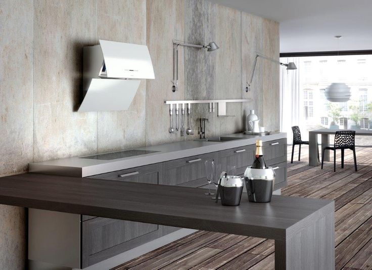The elegant shape of Mirror highlights its ergonomics and ease-of-use. The stylish shape leaves the cooktop free from a bulky hood and the new Touch Control offers functionality and ease. At a simple touch you can open electronically the upper panel so that odours are effectively and silently expelled. By closing it down, you will recreate the amazinggly unique elegant design. The whole kitchen will be reflected in the Mirror.