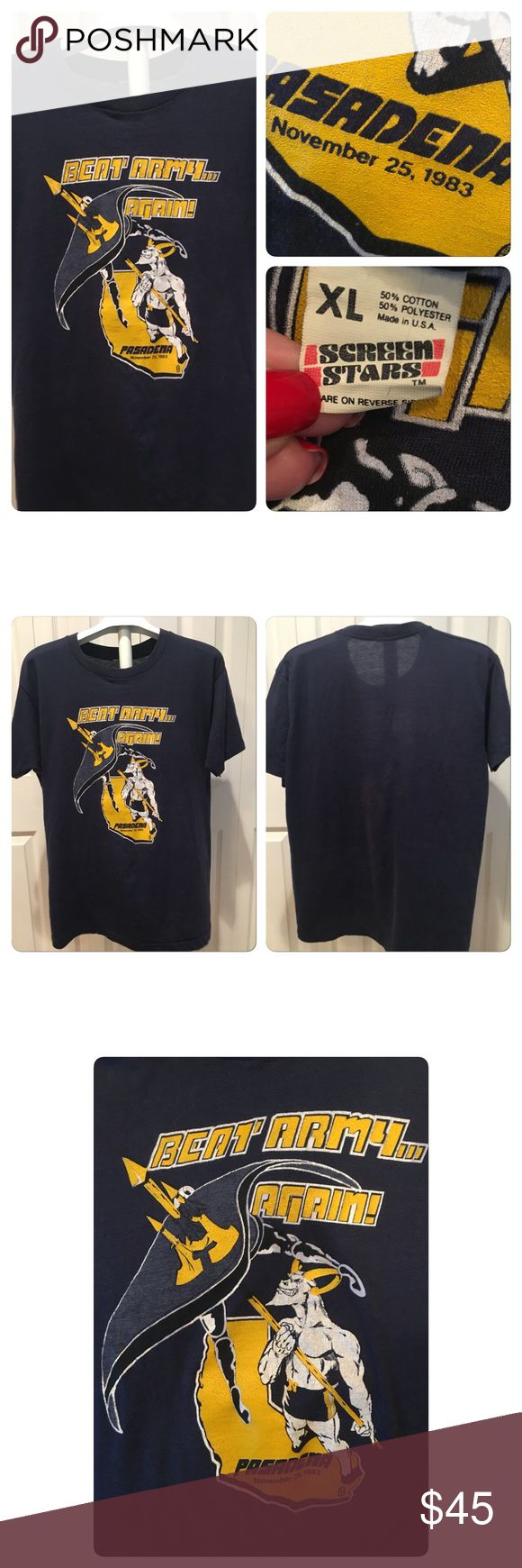 Vtg ARMY NAVY GAME ROSE BOWL 1983 tee 1983 Army Navy college football game. The game was played at the Rose Bowl in Pasadena, California. The Navy Midshipmen defeated Army Black Knits handily 42-13 to maintain their 41-30-7 advantage in the great rivalry series. Printed on a Screen Stars 50-50 Poly cotton navy blue paper thin tee. Bright graphics. Dated Nov 25 1983 . No holes stains rips or tears . Some slight fading and cracking of graphics gives it , it's awesome vintage appeal Vintage…