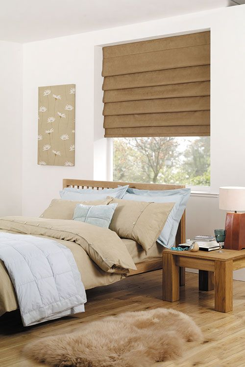 Nature inspires the colour of these bedroom roman blinds.