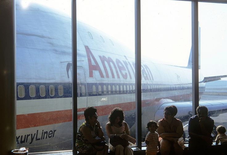 https://flic.kr/p/sVXpW7 | One of my dad's slides: People waiting at the American Airlines Terminal at JFK Airport with a brand new Luxury Liner 747 jet plane in the background. New York. Aug 1972 | We were at the airport to drop off our Los Angeles cousins who spent the entire summer with us at our house across the street from the beach in Milford, Connecticut. My father snapped this shot of some people sitting and waiting at the airport.   At the time, the 747 Luxury Liner was the largest…