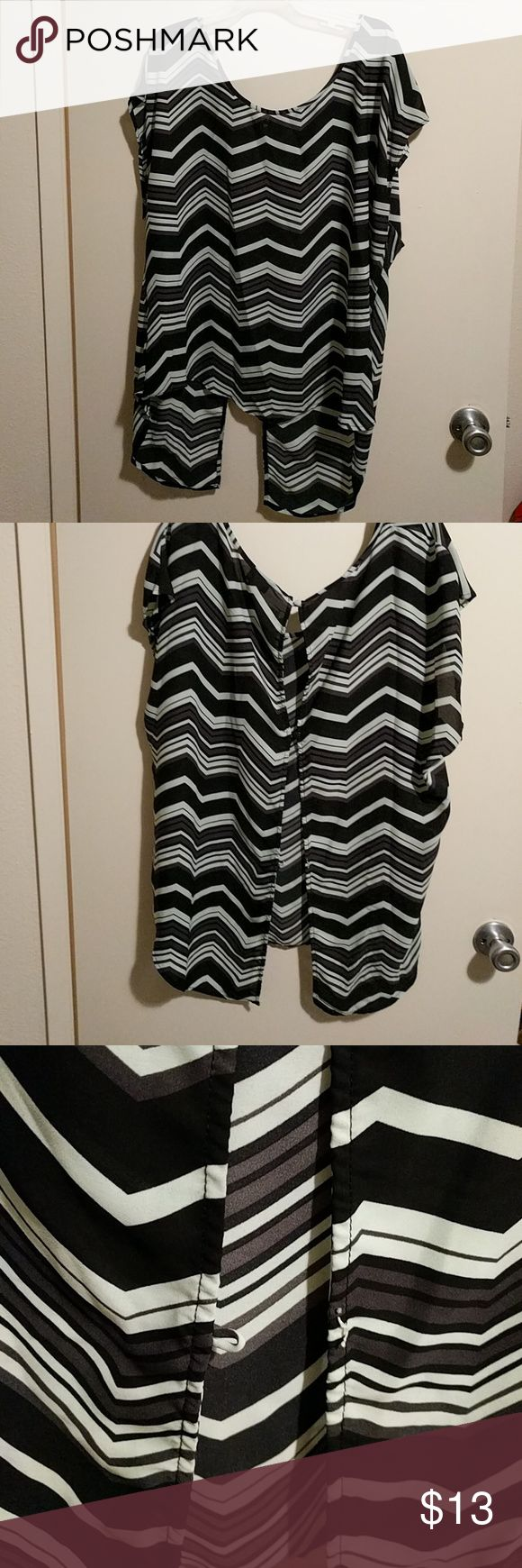 Torrid chevron top Cute and lightweight Chevron print top from Torrid.  Size 2x.  Only defect is one missing button in the back (pictured). torrid Tops