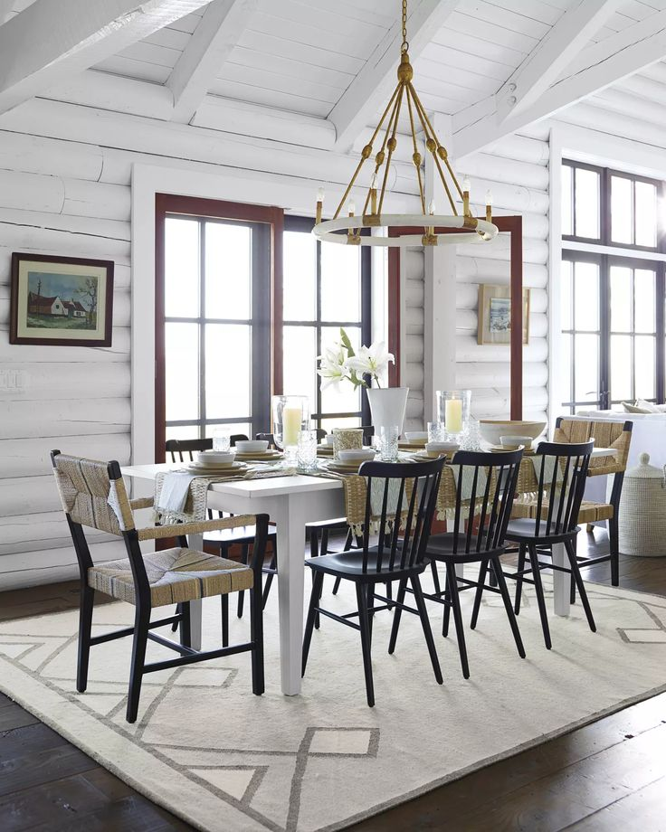 Bright White Walls Dining Table Black Chairs Faux Bois And Brass Pendant