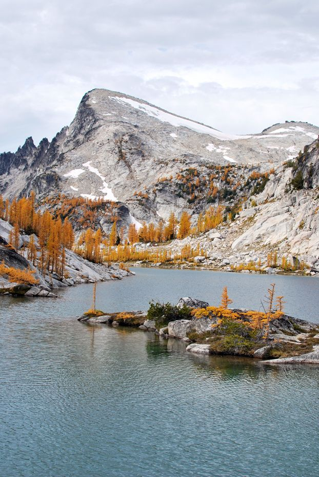 Grey snowy mountains with yellow trees-emerald pond Co