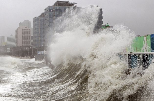 High waves caused by Typhoon Sanba crash on Haeundae beach in Busan, south of Seoul, South Korea, Monday, September 17, 2012.