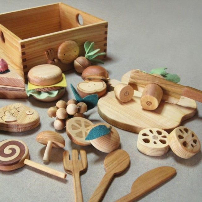 For kids: a natural wood kitchen play set made from different types of wood.