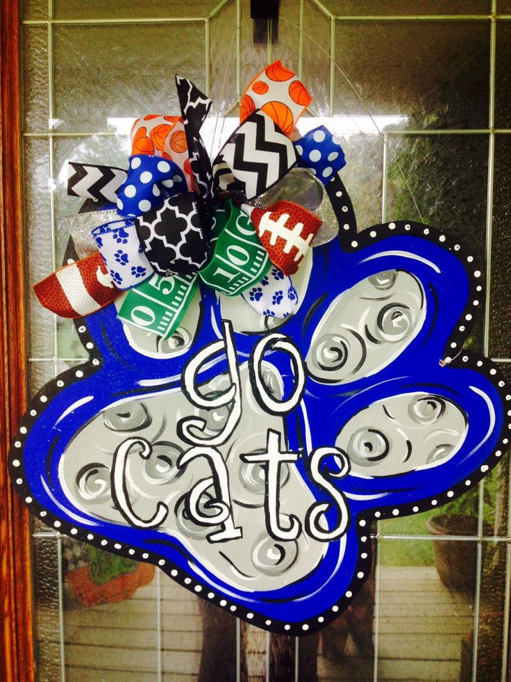A personal favorite from my Etsy shop https://www.etsy.com/listing/250238983/kentucky-wildcats-paw-print-door-hanger