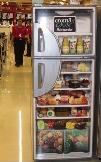 Graphic design installed on the surface of a Croma fridge door to show how to effectively use the space inside.