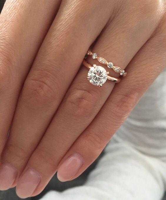 Rose gold solitaire engagement ring with Art Deco wedding band