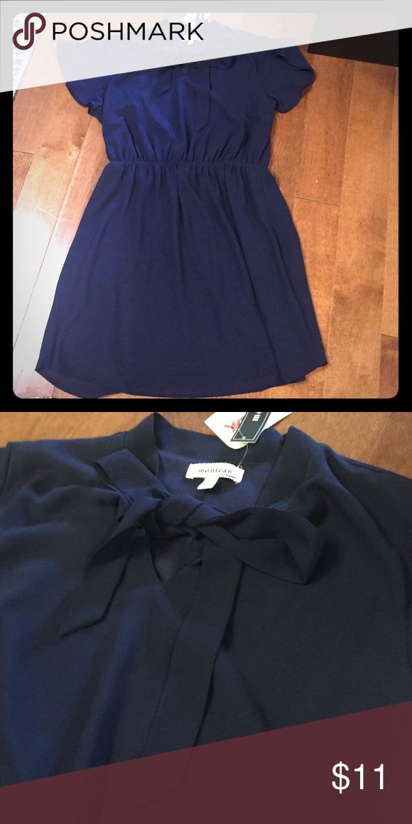 Navy blue mini dress This navy blue mini dress with a bow at the top is perfect for work or dinner dates.  The flared sleeves are perfect for a spring or summers day! Monteau Dresses