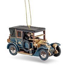 Have your holiday arrive in Downton style with this classic early 1900s model car ornament!