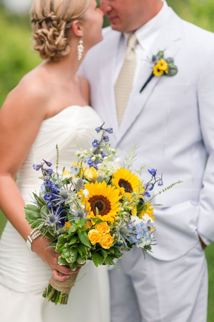 Such a gorgeous bouquet with sunflowers combined with delphinium, roses and blue thistle ~ we ❤ this! moncheribridals.com