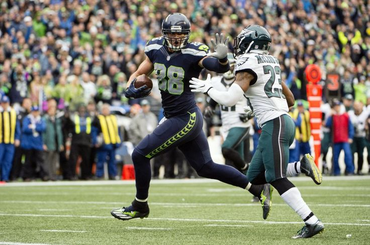 Seattle Seahawks tight end Jimmy Graham (88) stiff arms Philadelphia Eagles free safety Rodney McLeod (23) during the second quarter as he scores a touchdown at CenturyLink Field.(Troy Wayrynen|USA TODAY Sports)