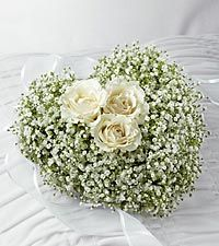 Baby's braeth heart with white roses.  A simple funeral arrangement.  Could put a candle in the middle too...