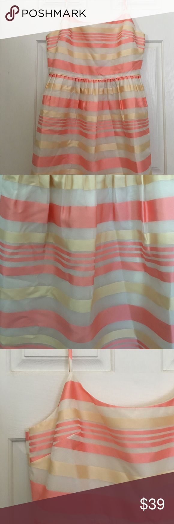 J.Crew Factory Striped Occasion Dress! NWT J.Crew Factory Occasion Dress. Champagne and soft pink horizontal stripe lined with off-white. Pockets! Side zip. Adjustable spaghetti strap. Falls above knee. Factory size 14, fits like a jcrew 14 maybe a bit roomier. Never worn! Perfect for a casual summer wedding! J. Crew Factory Dresses Wedding