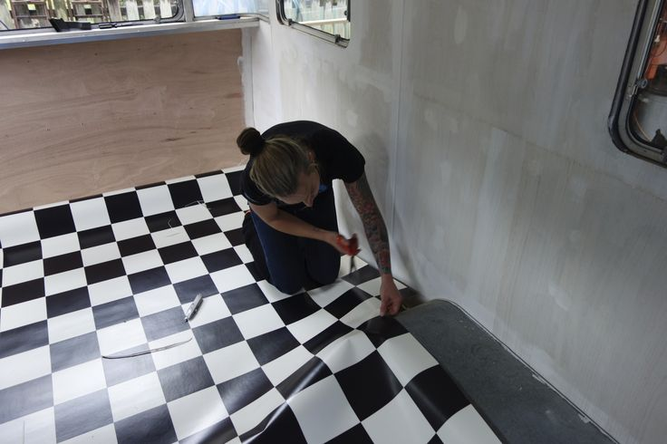 Wrestling with the checkered lino from Bunnings, which was measured incorrectly which was a lovely surprise to get to the end and be 20cm too short! They gave me another 1.5m, which of course involved me being an extremely accurate cutterer and joinerer ;)