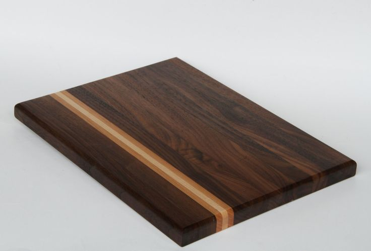 A personal favorite from HouseOfCuttingBoards.com https://houseofcuttingboards-com.3dcartstores.com/The-Victoria-cutting-board--Walnut-Maple-and-Cherry_p_18.html