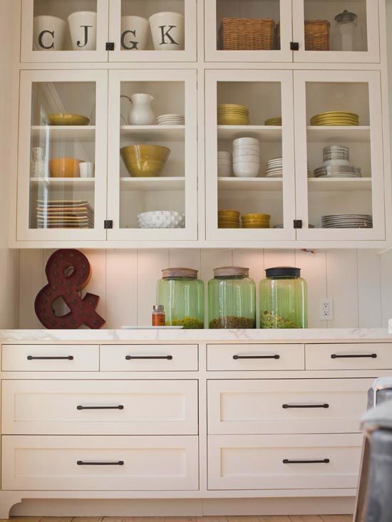 Love this built in storage cabinet and all the glass