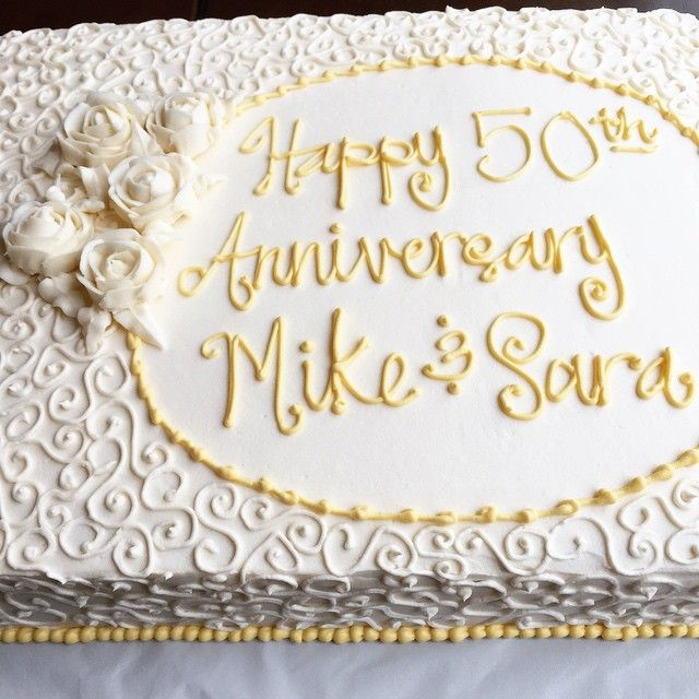 Happy 50th wedding anniversary to my wonderful grandparents! Vanilla sheet cake with vanilla buttercream, covered in scrolls and roses!
