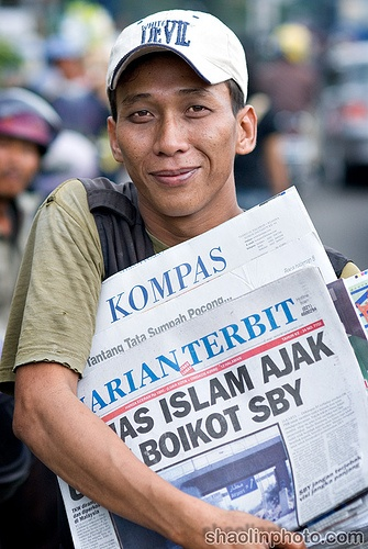 Newspaper Seller on the Streets of Jakarta