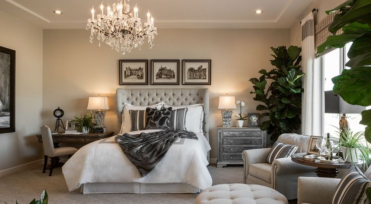 Mid-Range Transitional Bedroom Design  Desk at nightstand, upholstered headboard, two chairs & ottaman
