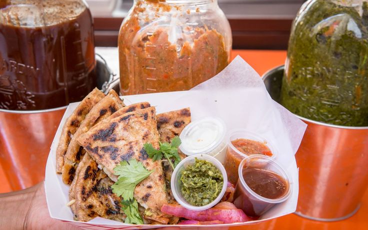 Parontha - Grand Trunk Road is stuffing fresh roti with options like spicy potatoes, chickpeas, or avocado and butter fruit.