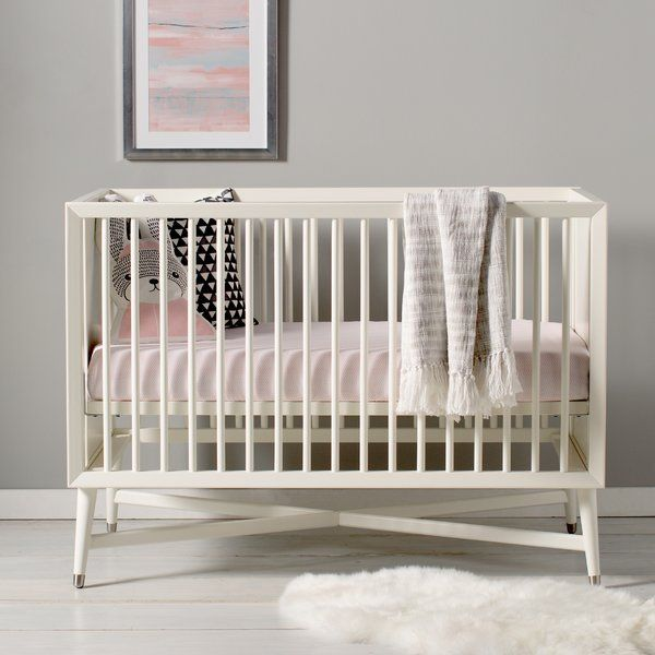 Simply beautiful - a classic style that's the centerpiece of the nursery. With an x-base structure and tapered cone-shaped legs, our Mid-Century Crib has the feel of a vintage classic with modern day updates such as metal sabot detailing on the legs and a beautiful finish.Crib can be converted to a Day Bed or Toddler Bed with use of a Toddler Guard rail (sold separately).