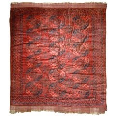 """I picked up a red ethnic-looking rug at a garage sale that looks like it's been through the ringer more times than this one. Some people say """"worn""""; I call it """"character""""."""