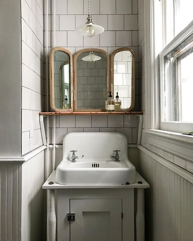 Tiled Half Bath With Antique Tri Fold Mirror