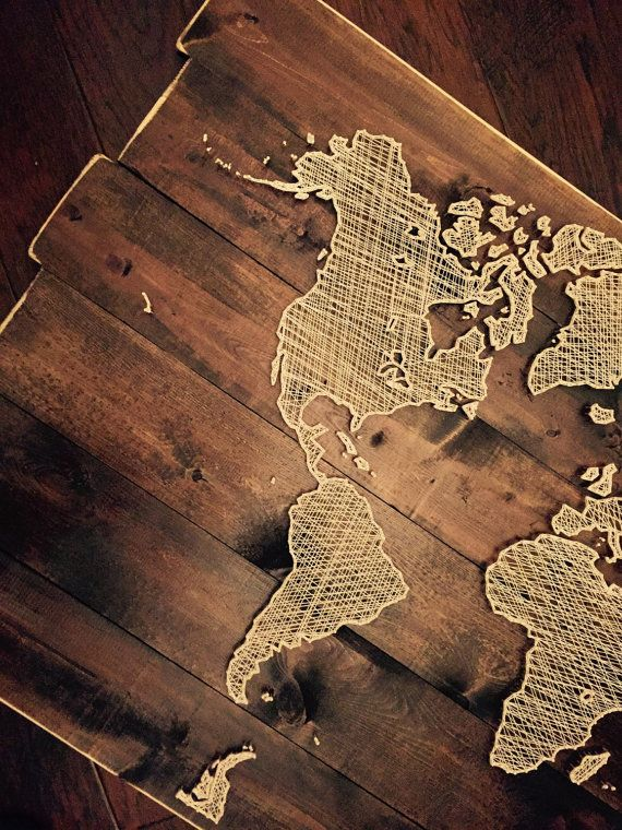 World map string art. This is currently the largest piece that we offer for sale (however custom orders can be any size). Measurements are approximate at 50 wide x 33 tall. This is a very detailed version of the world map. The string will be cream unless otherwise noted at checkout.