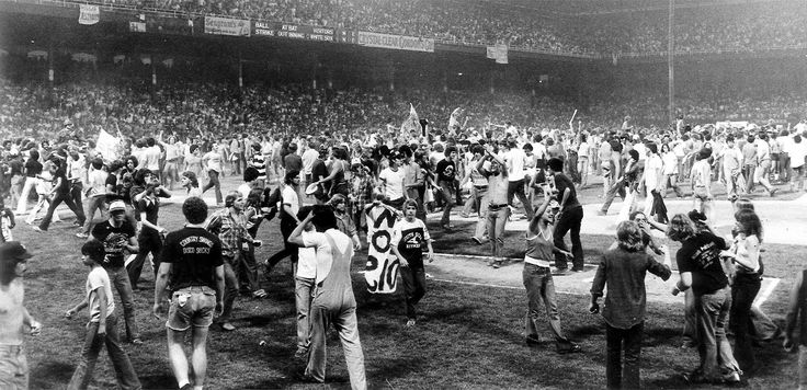 """July 12, 1979 - Chicago White Sox owner Bill Veeck's """"Disco Demolition Night"""" promotion at Comiskey Park went awry when fans set fire to disco records on the field as planned between games of a doubleheader against the Detroit Tigers but then refused to return to their seats. The second game had to be forfeited."""