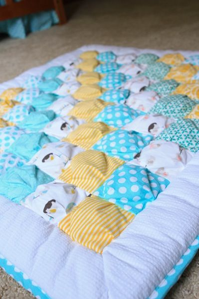 Puff quilt, have PDF tutorial. Love the colors in this quilt, especially the elephant fabric