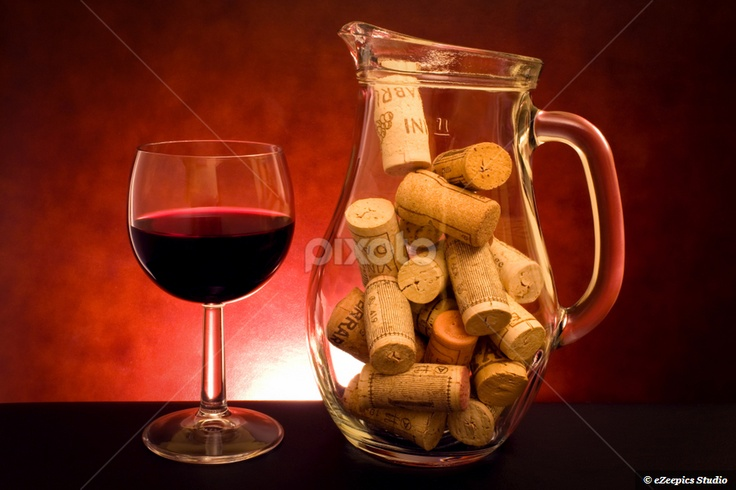 Still Life With Wine  Stock photo available in jpg format or canvas print at Pixoto: Drinks - Still life with glass of wine and jug with cork caps.