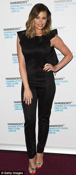 Smart: Jess looked elegant in the black jumpsuit while MIC star Emma Miller wowed in a blu...