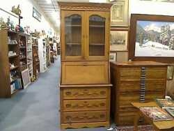 Great turn-of-the-century oak, 2 piece secretary with beautiful, original hardware. $685.00 - Denver Brass Armadillo Antique Mall.