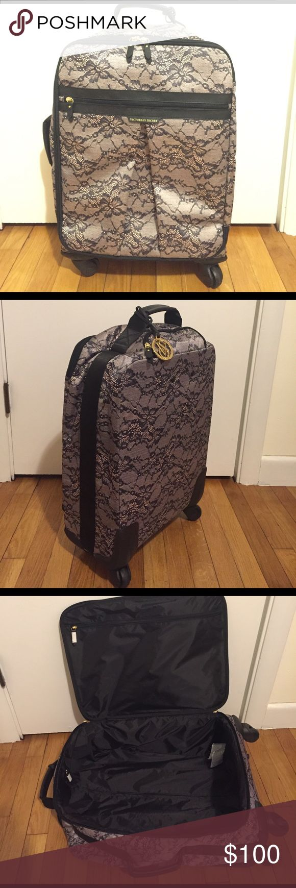 Victoria's Secret Rolling Luggage Lace print Victoria's Secret Rolling Luggage. Brand new only used once! Perfect small carry on, just doesn't suit my needs.         20H x 14W x 10D Victoria's Secret Bags Travel Bags