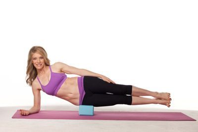 Place your right hip on a yoga block & right elbow on the ground. Engage your side-waist muscles (obliques & quadratus lumborum) to raise your legs to hover 4-6 in. above the ground. Make sure shoulders, pelvis & ankles line up & that the 2 legs remain glued together. Sustain the position while breathing deeply for 1 min., then switch sides. // Targets the interface of both oblique layers and the deep lateral stabilizer, the quadratus lumborum. It also strengthens portions of the iliopsoas.