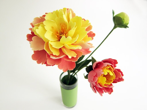 this is so AMAZING! these flowers are made from clay by artist Yukiko Miyai!