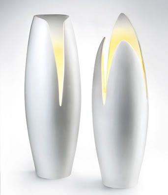 a twin lamp, having a similar shape, but not exactly the same, stainless steel makes good combination with yellow lighting