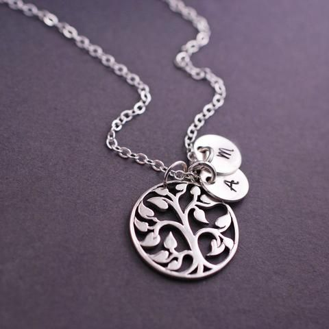 A 3/4 inch sterling silver tree is hanging from sterling silver chain. Available in 16, 18, 20, 24 or 30...