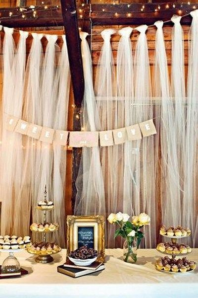 Tulle backdrops can instantly add visual interest and cover a magnitude of imperfections.  See more bridal shower decorations and party ideas at www.one-stop-party-ideas.com