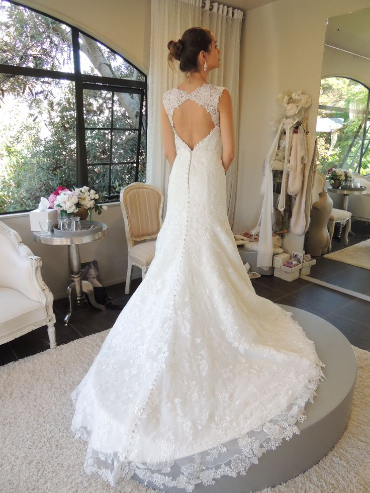 """Style """"Winter""""  IVORY SIZE 10 ( Couture Lace keyhole back mermaid style, Swarovski crystals on the back train)   WAS $3750 NOW  $2500  More dresses at jennysbridal.co.nz !"""